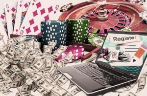 Seteleitä, tietokone, pelimerkkejä, pelikortteja ja rulettipyörä